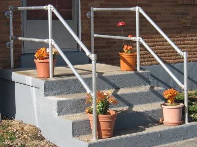 Stairs with Flowers and Pipe Fitting Rails